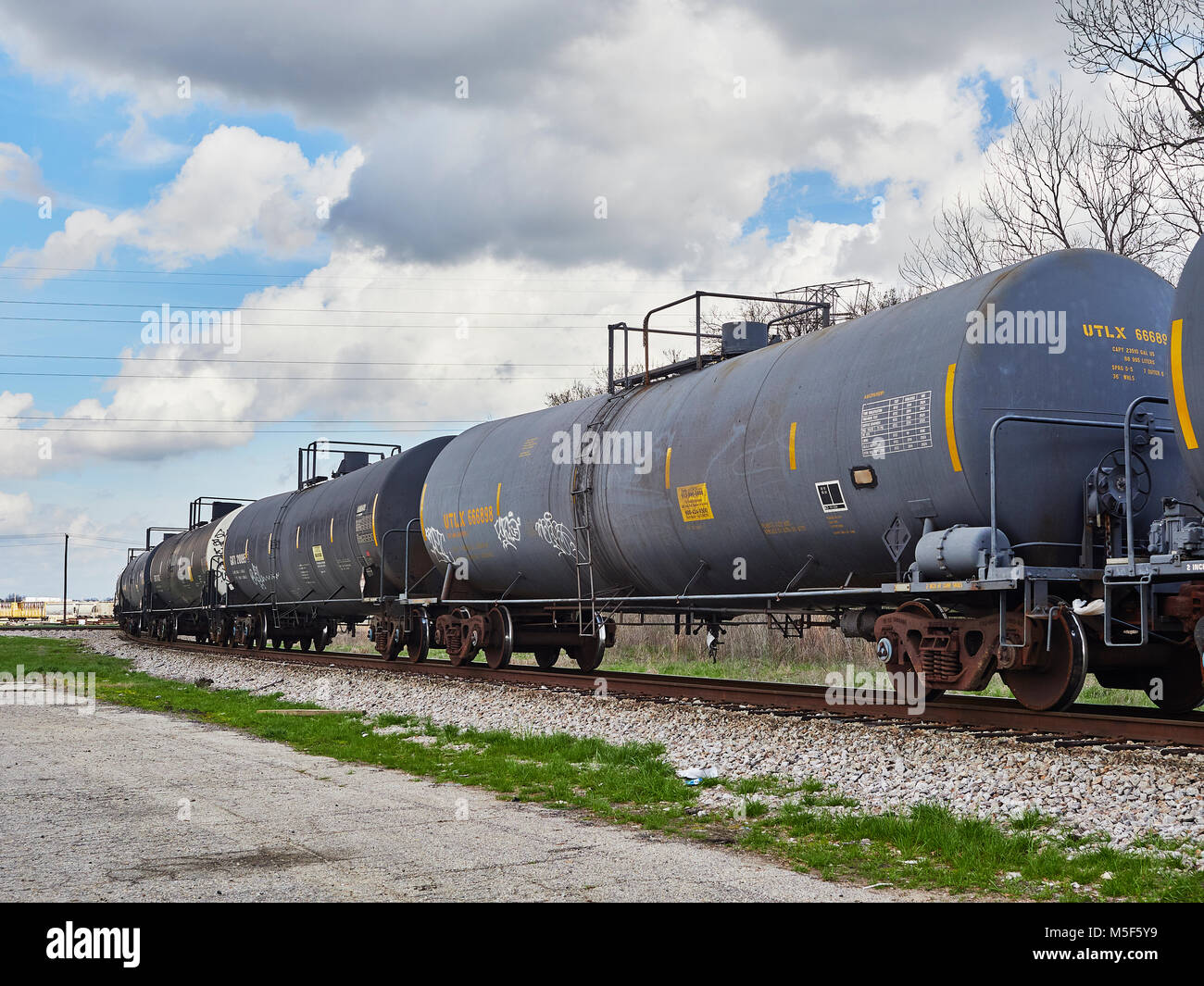 Railroad or train tank cars waiting on a siding in the Montgomery Alabama, USA, CSX switching yard. - Stock Image