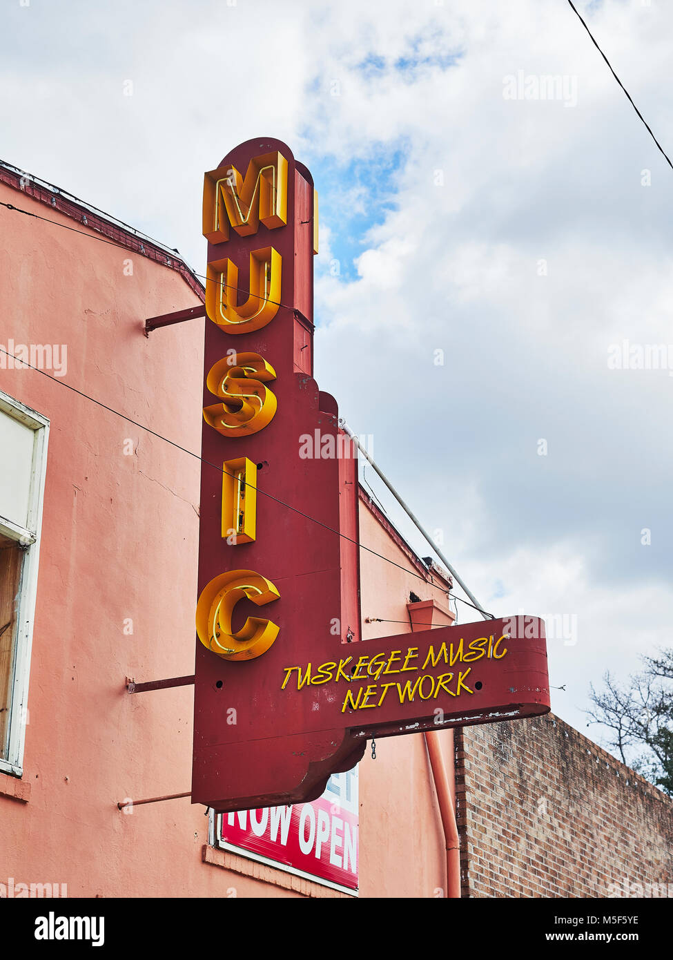 Old vintage neon exterior sign for Tuskegee Music Network store, shop or  business in Tuskegee Alabama, USA. - Stock Image