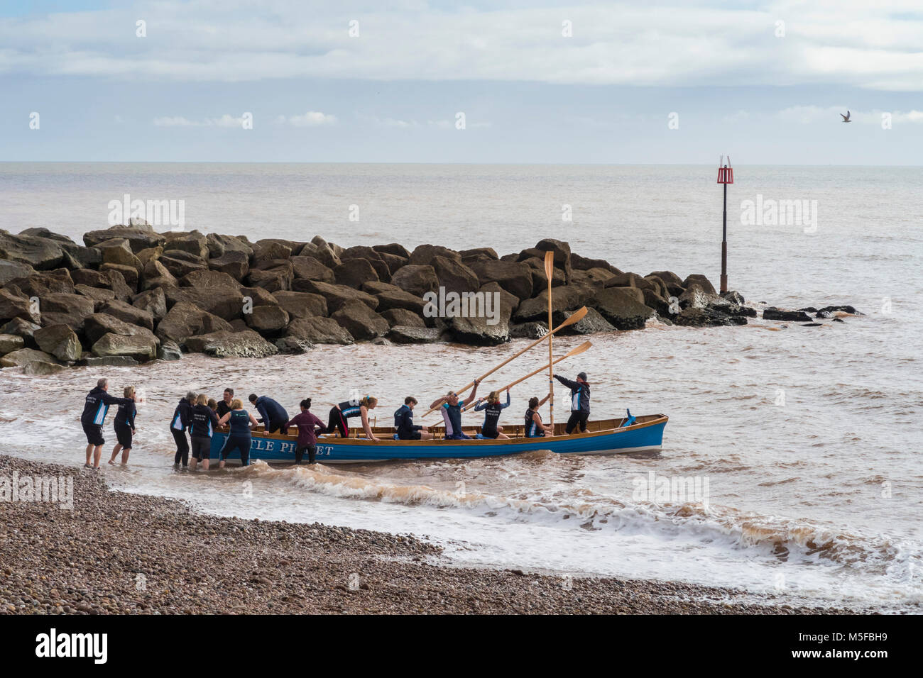 Launching a new Pilot Gig boat the 'Little Picket' at Sidmouth, Devon - Stock Image