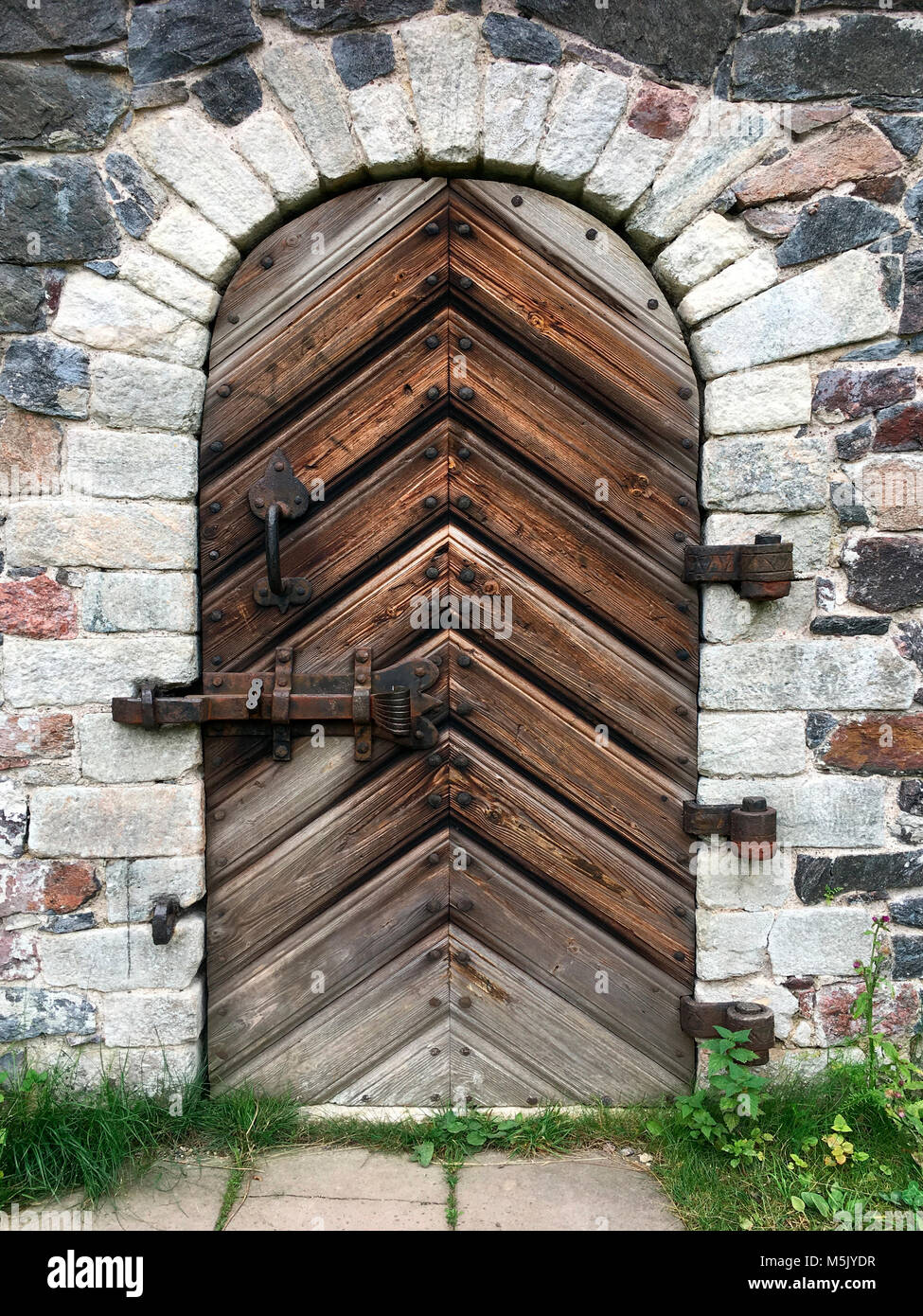 Old door in a fortress - Stock Image