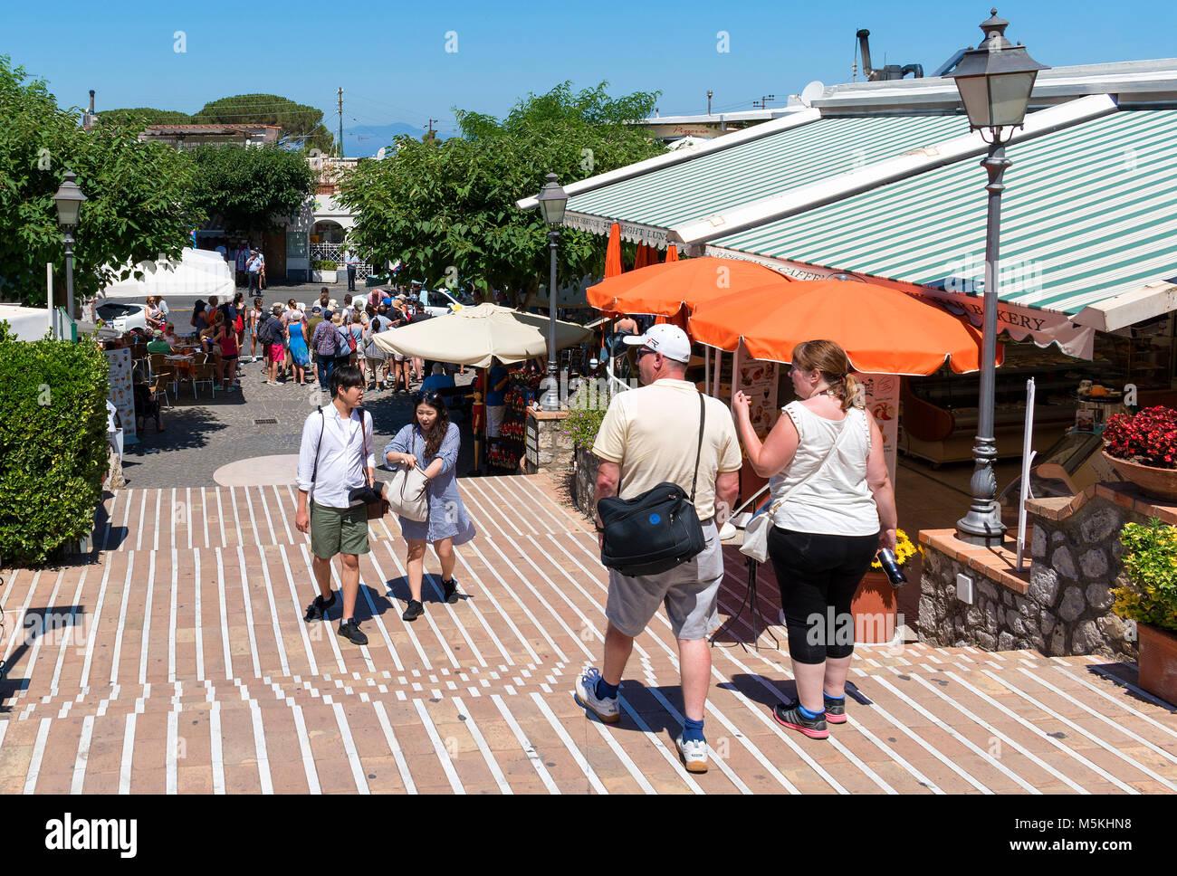 tourists on piazza vittoria in anacapri on the island of capri, italy. - Stock Image