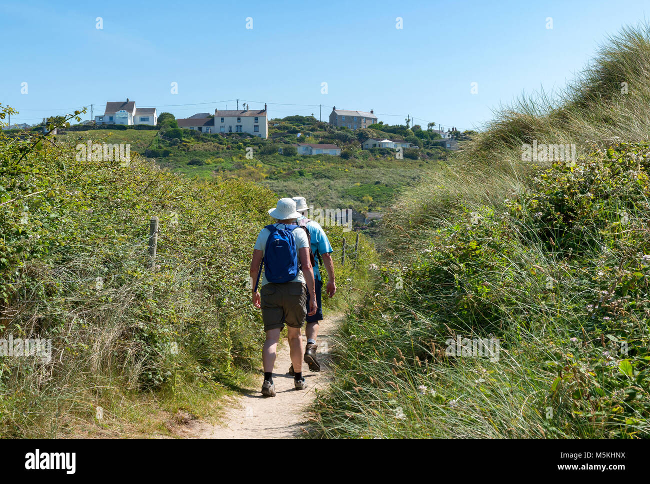 people walking on the south west coast path nears ennen cove in cornwall, england, britain, uk, - Stock Image