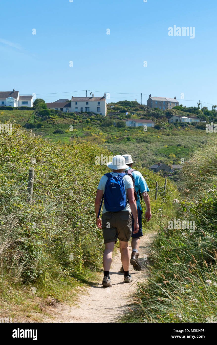 people walking on the south west coast path near sennen cove, cornwall, england, britain, uk. - Stock Image