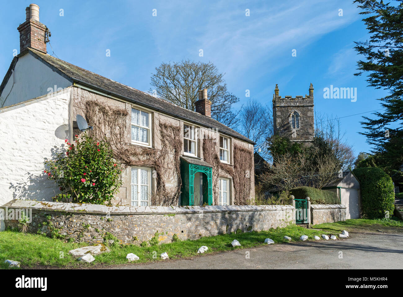 cottage and church in the cornish village of manaccan, cornwall, wngland, britain, uk. - Stock Image
