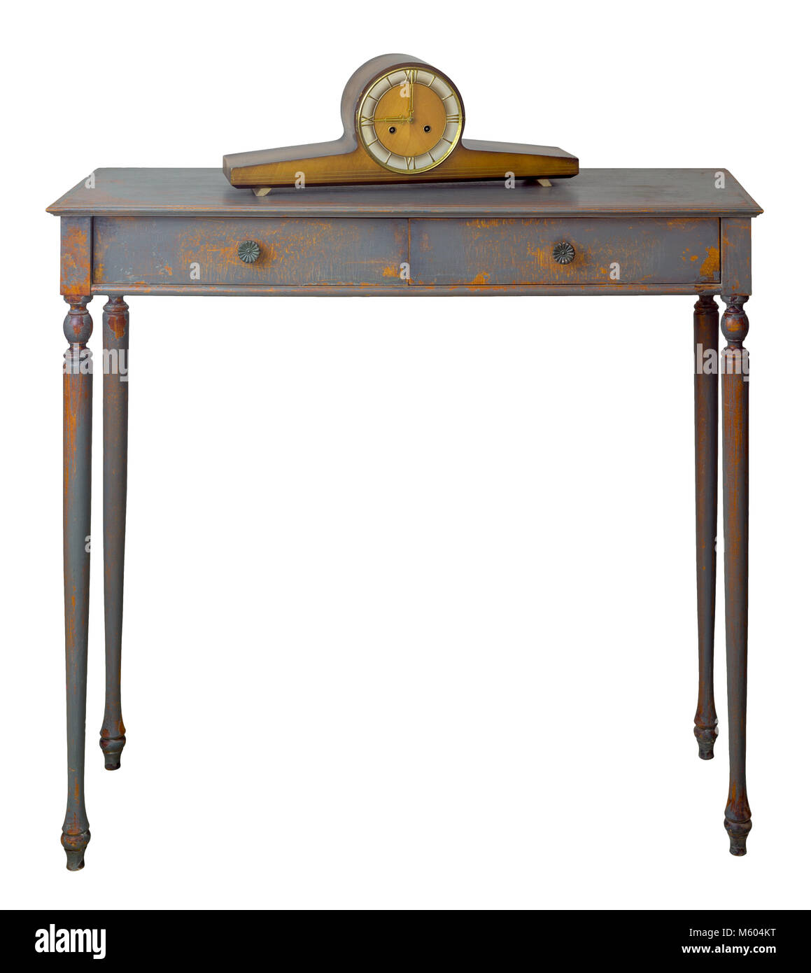 Vintage Furniture - Old style desktop clock on the top of retro wooden vintage table with two drawers painted in - Stock Image