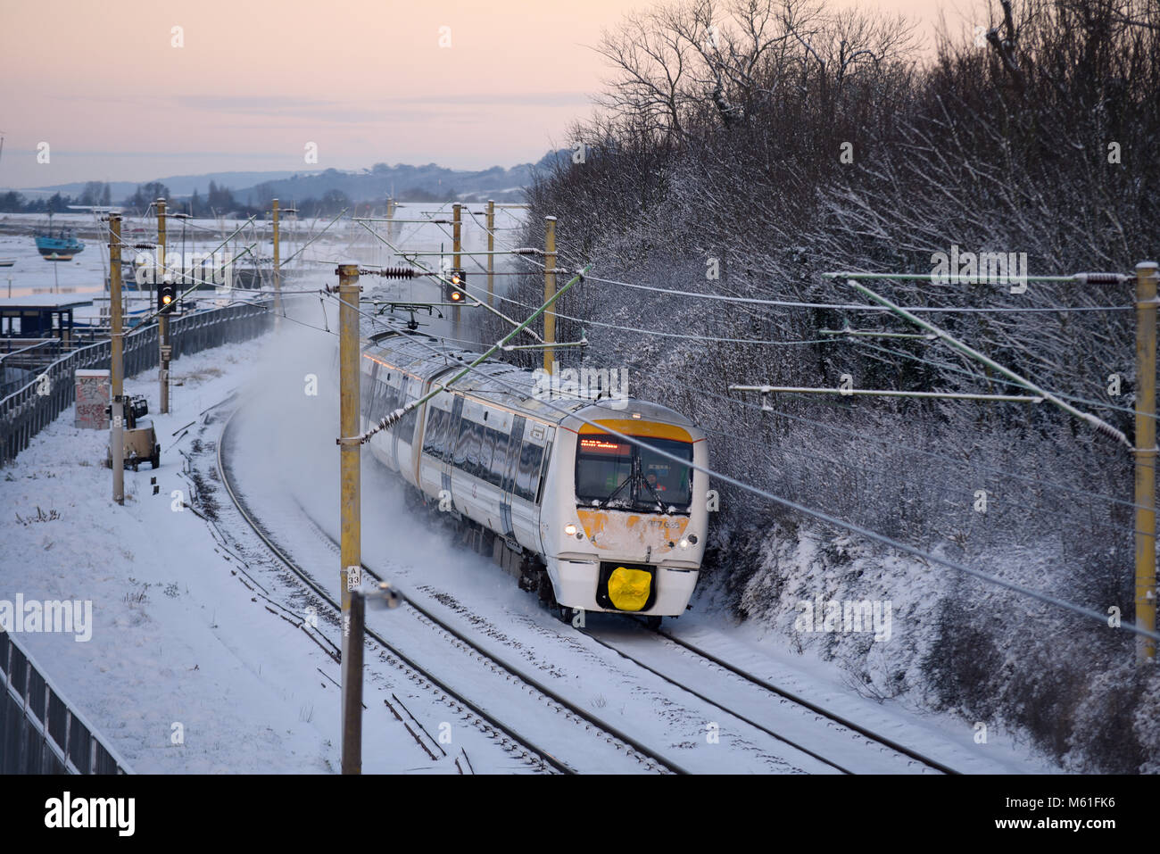 train-in-snow-c2c-railway-train-running-through-snow-covered-lines-M61FK6.jpg