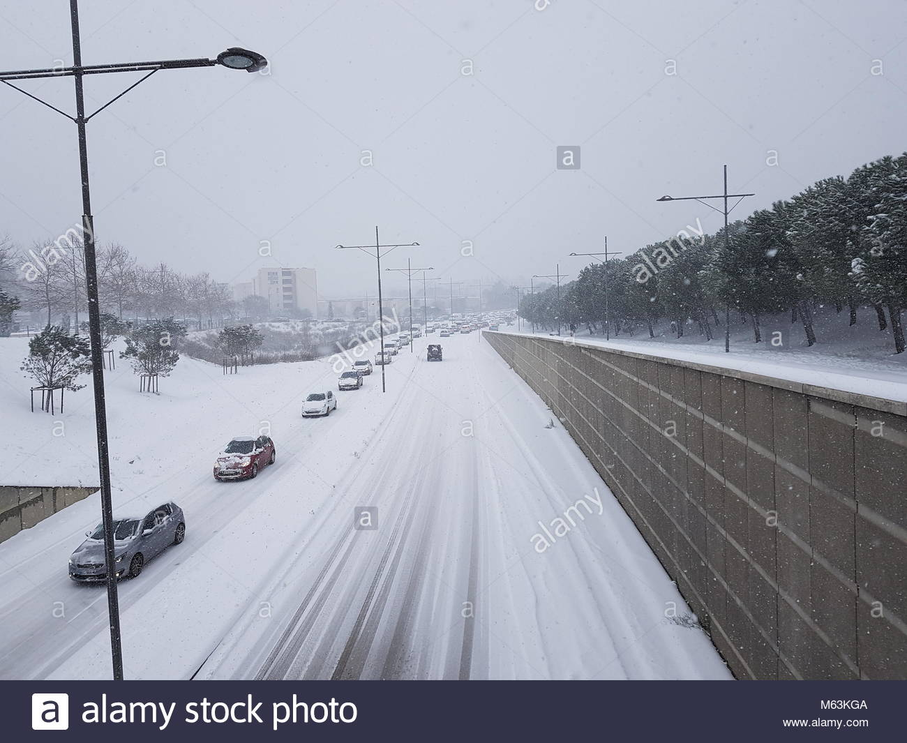 montpellier france 28th feb 2018 cars drive on a snow covered stock photo 175872826 alamy. Black Bedroom Furniture Sets. Home Design Ideas