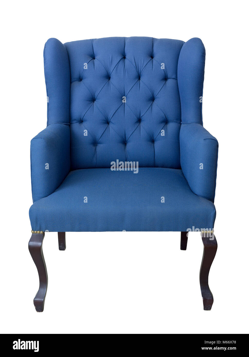 Vintage Furniture - Front shot of French blue wingback armchair with dark brown wooden legs isolated on white background - Stock Image