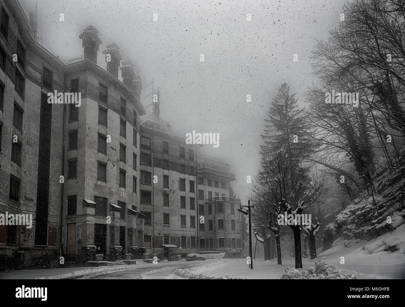 ancient hotel abandoned under a heavy snowfall, Campo dei Fiori Varese - Stock Image