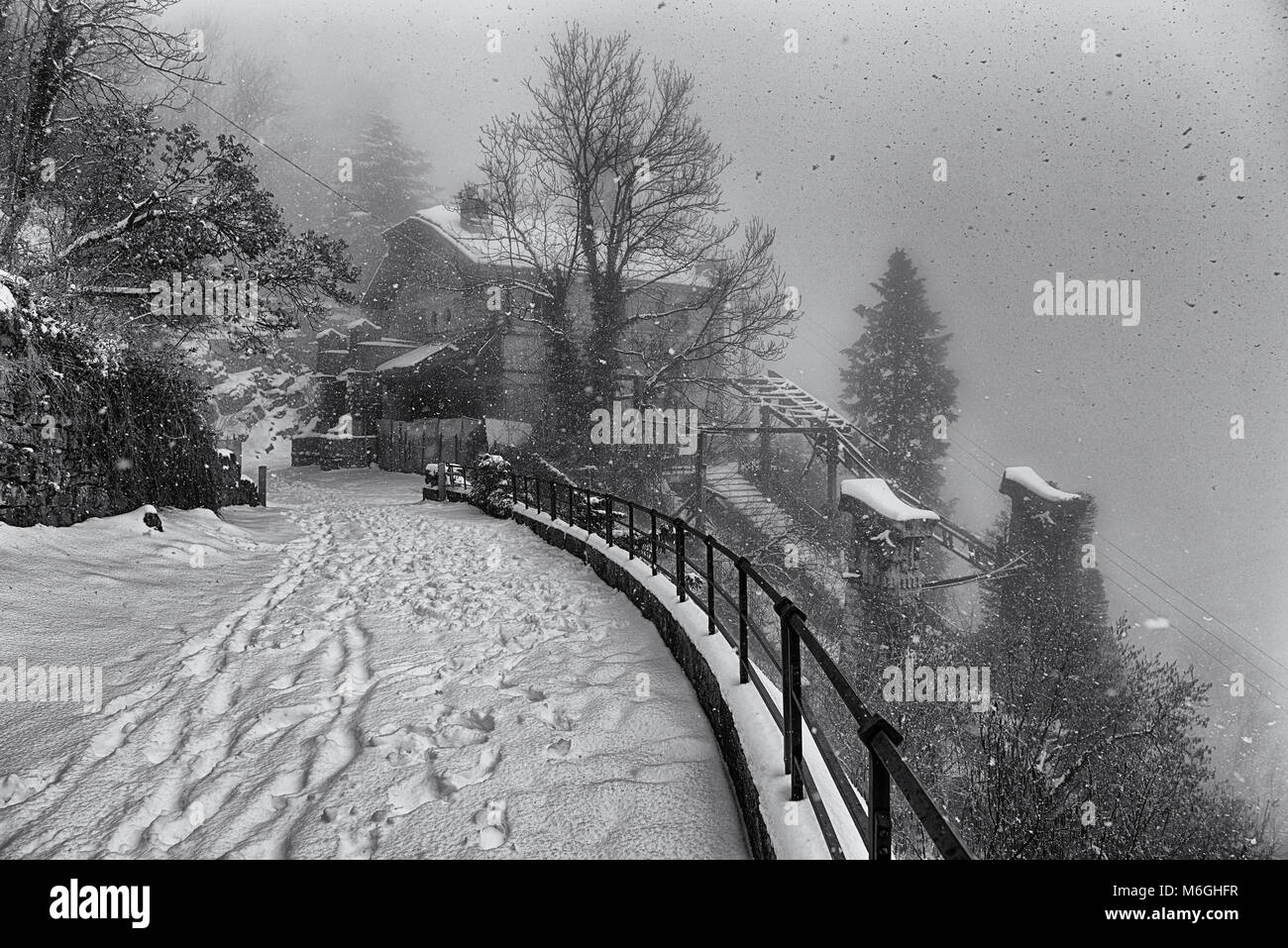 Ancient station of the funicular abandoned under the snow - Stock Image