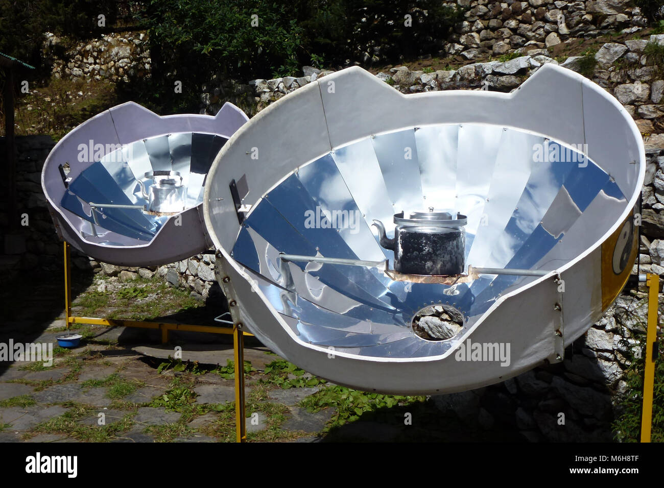 Picture of a parabolic solar heaters for hot water, Pangboche, Everest Base Camp trek, Nepal - Stock Image