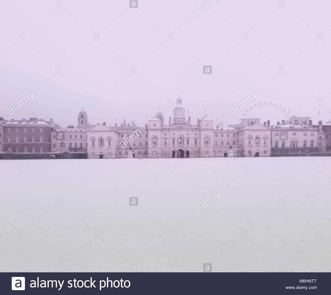 Horseguard's Parade and the London Eye covered in snow in winter - Stock Image