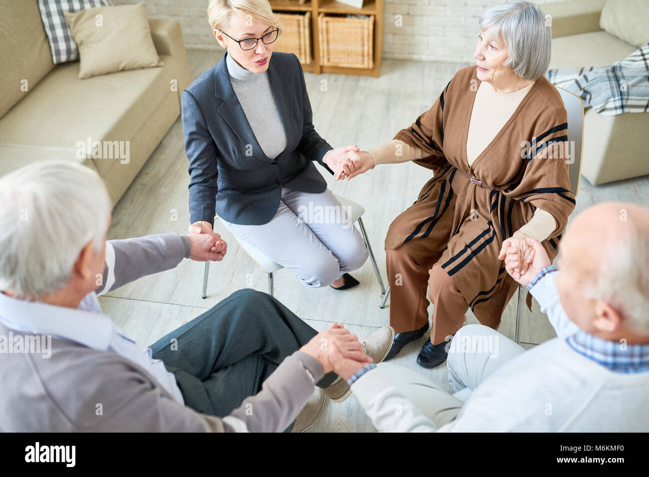 Support Circle in Group Therapy Session - Stock Image
