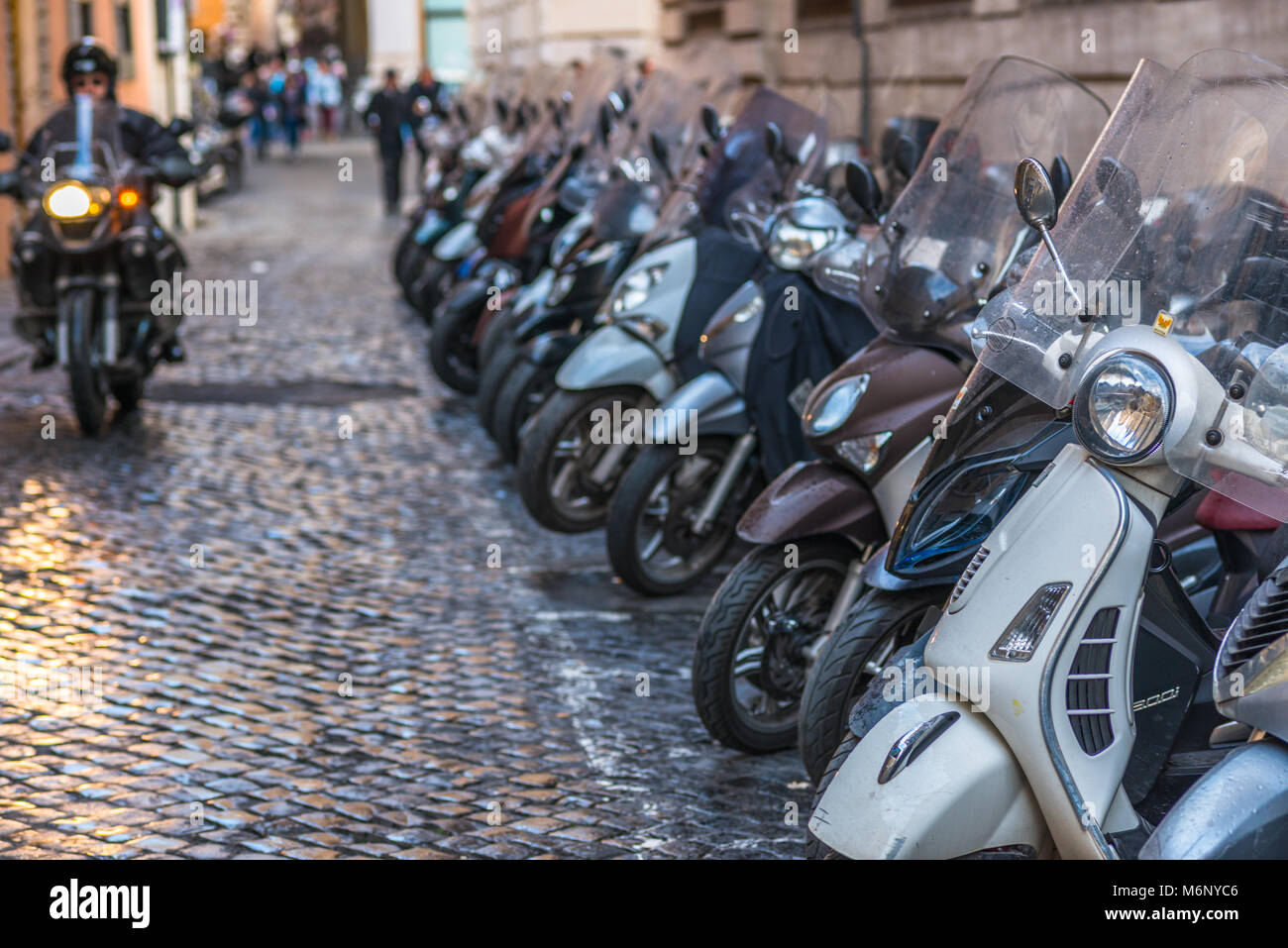 vespas-and-other-motorcycles-on-rome-cob
