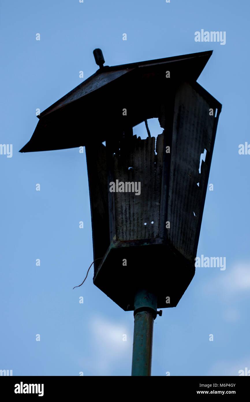 Broken hooligans street lamp - Stock Image
