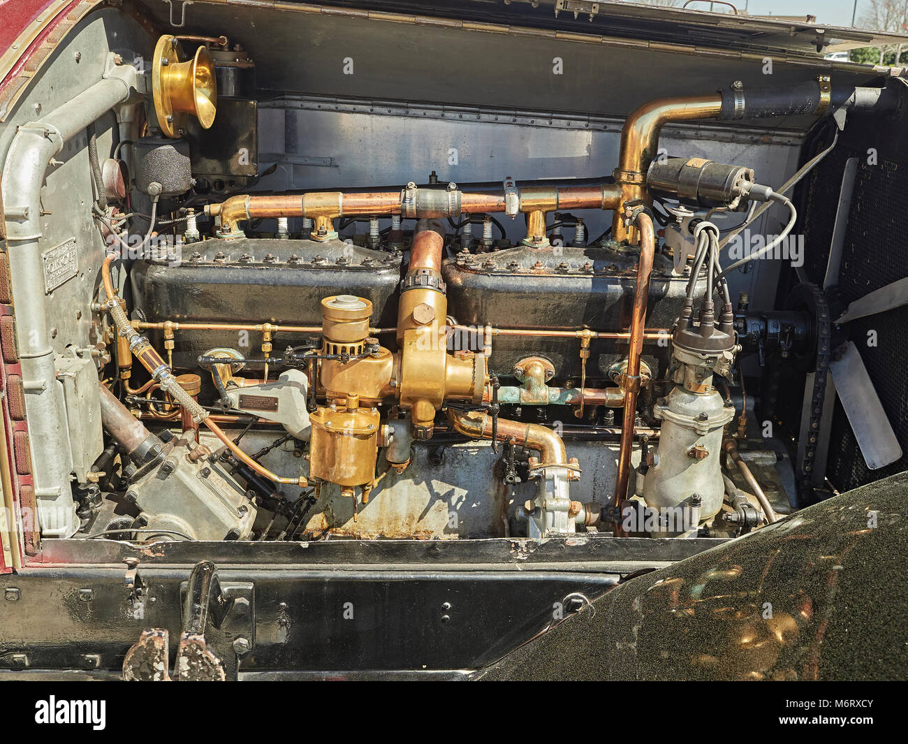 Engine compartment or motor bay of an antique 1924 Rolls Royce Silver Ghost showing the six cylinder motor of the - Stock Image