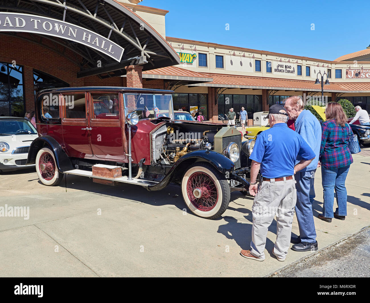 British classic car enthusiast looking over a 1924 Rolls Royce Silver Ghost limousine at a local car show in Pike - Stock Image