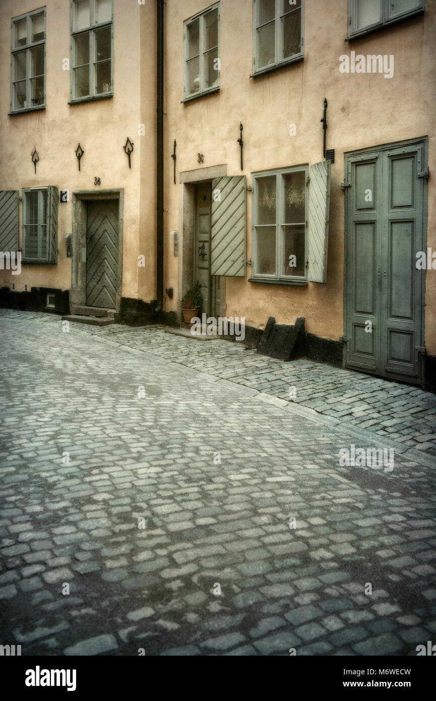 Houses on a cobbled street in the Gamla Stan (old town) district of Stockholm, Sweden - Stock Image
