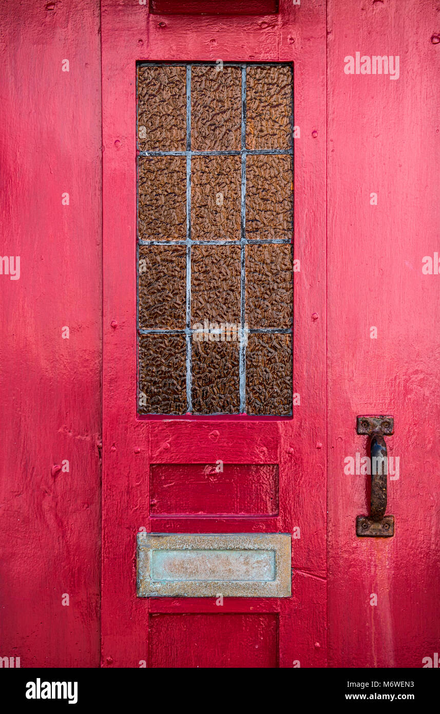Detail of a red front door to a house - Stock Image