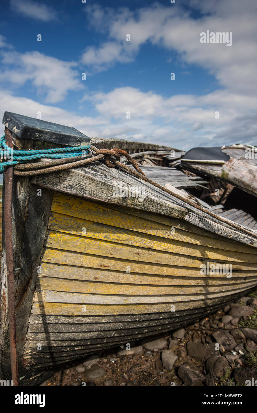 Yellow boat in Badachro harbour, Wester Ross, Scotland - Stock Image