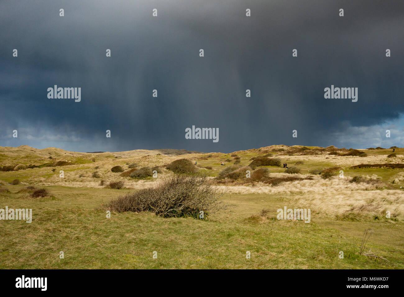 rain and storm clouds at perran downs, perranporth, cornwall, england, uk. - Stock Image