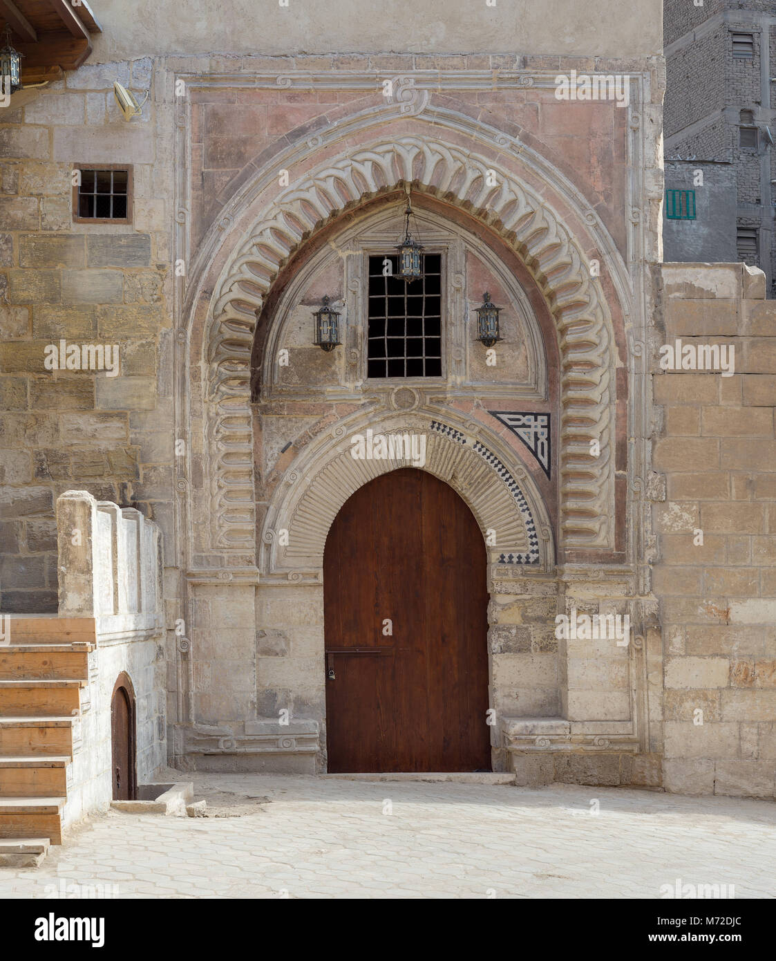 Gate of Darb Al Labana alley, a Bahari Mameluke era gate with small window covered with iron bars and decorated - Stock Image