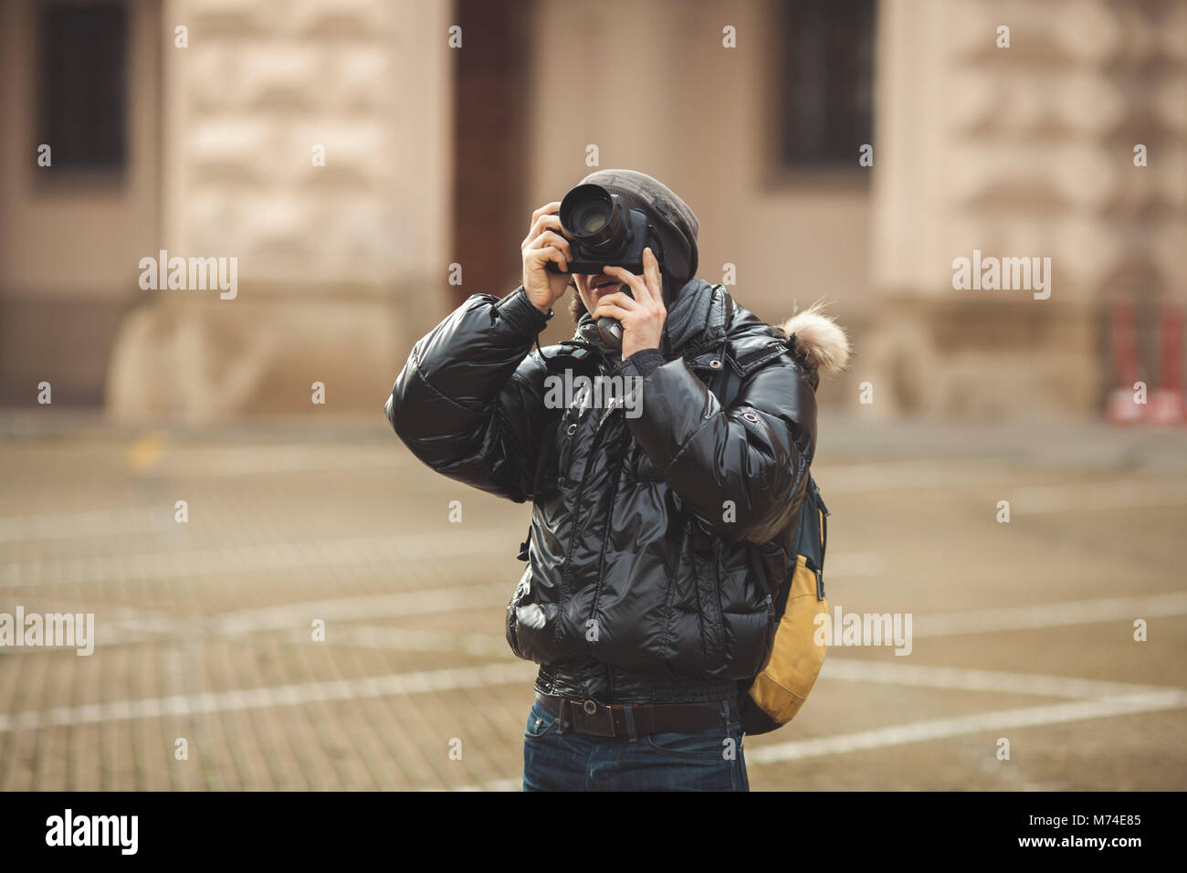 Tourist Man shooting in Prague, walking on the streets - Stock Image