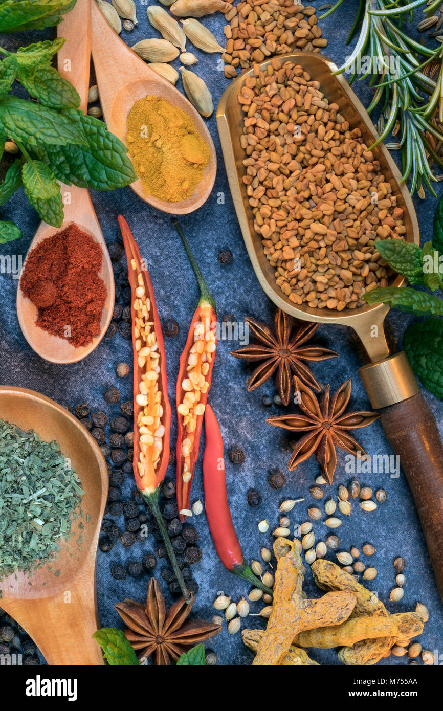 Herbs and spices used to add flavor when cooking. - Stock Image