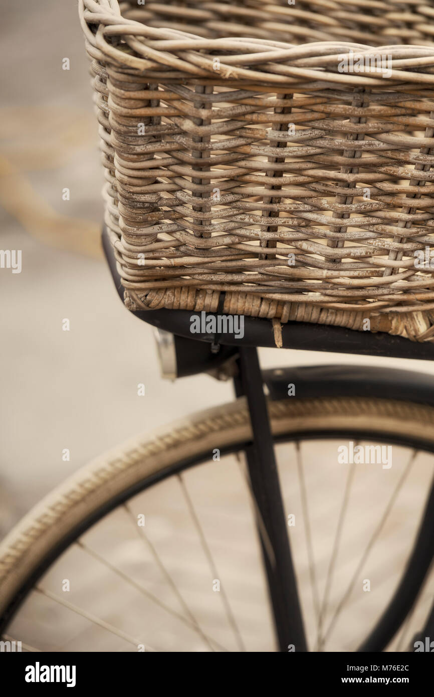 Detail of the front of a bicycle with a basket - Stock Image