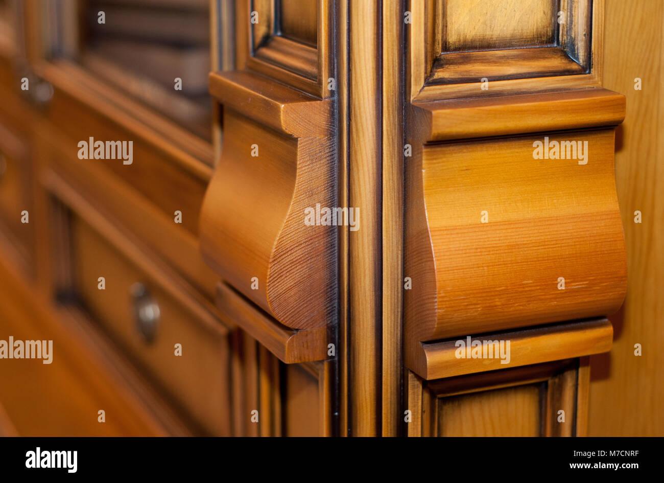 detail of a beautiful wooden closet close-up - Stock Image