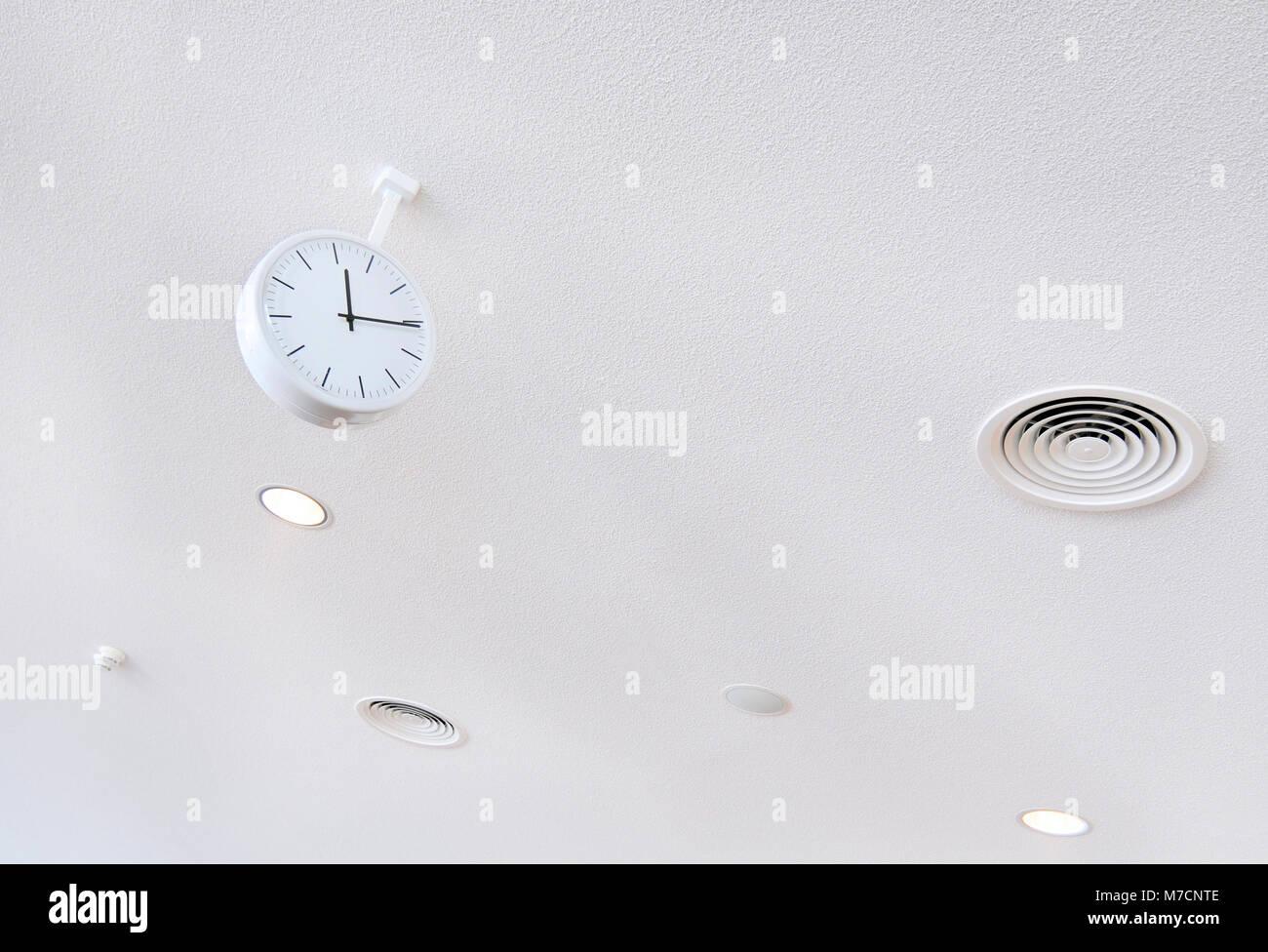 white clock on white futuristic background close-up - Stock Image