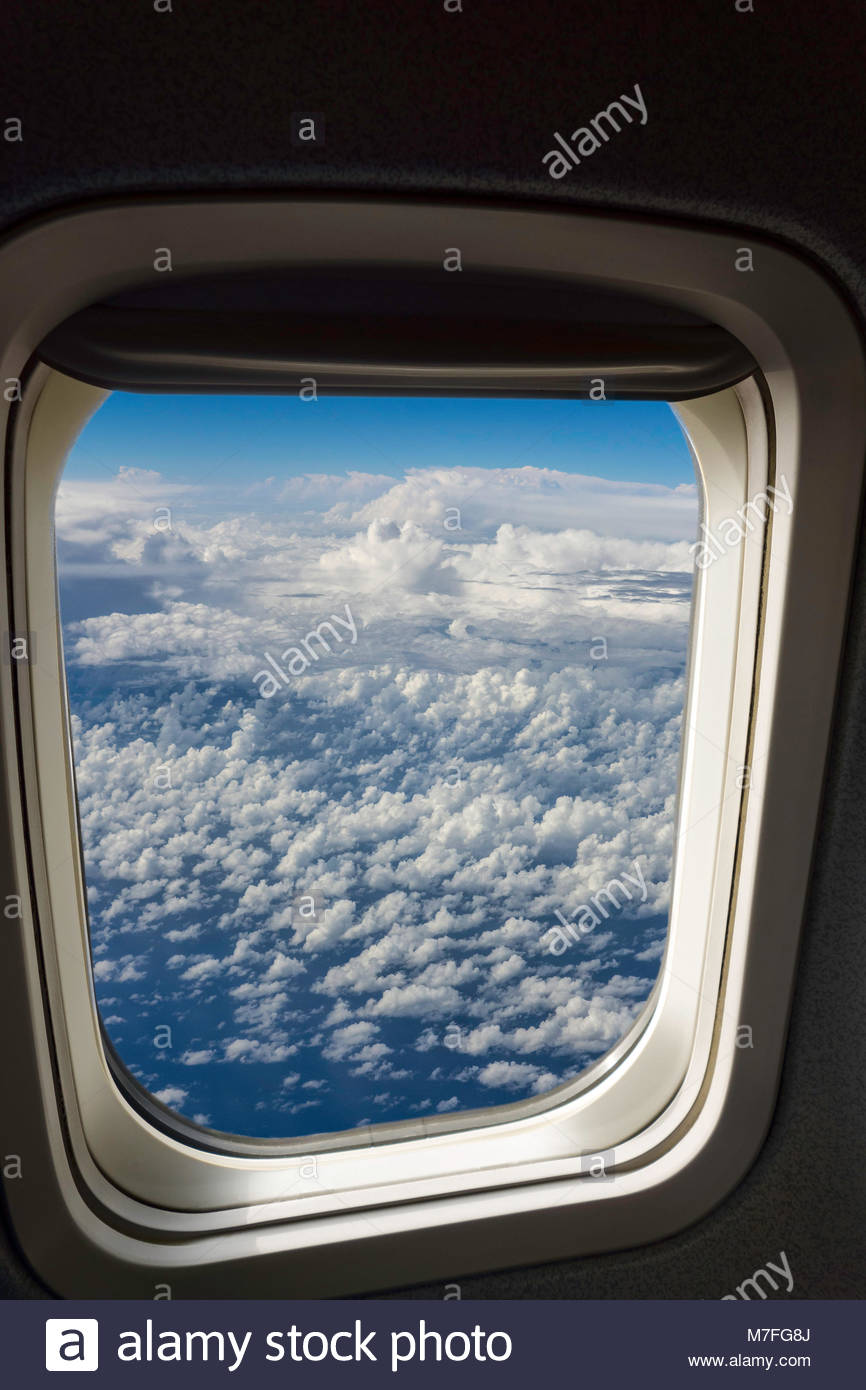aircraft-window-seat-view-of-clouds-from