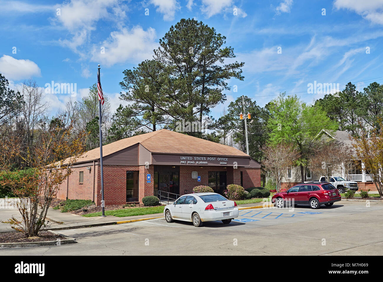 Exterior front entrance to the rural small town Post Office in Pike Road, Alabama, USA. - Stock Image