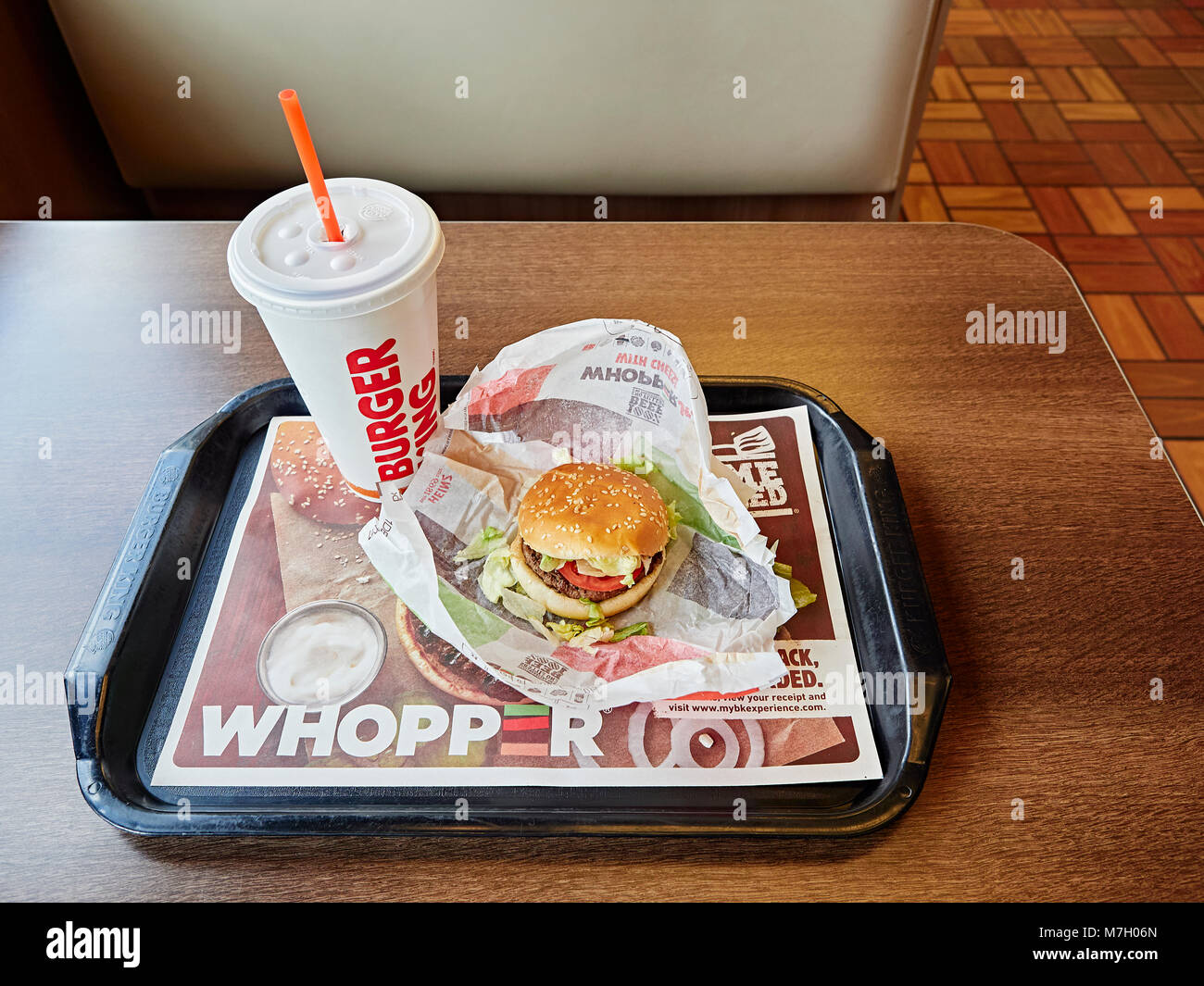 Burger King whopper hamburger and cold drink on the fast food restaurant dinner tray. - Stock Image
