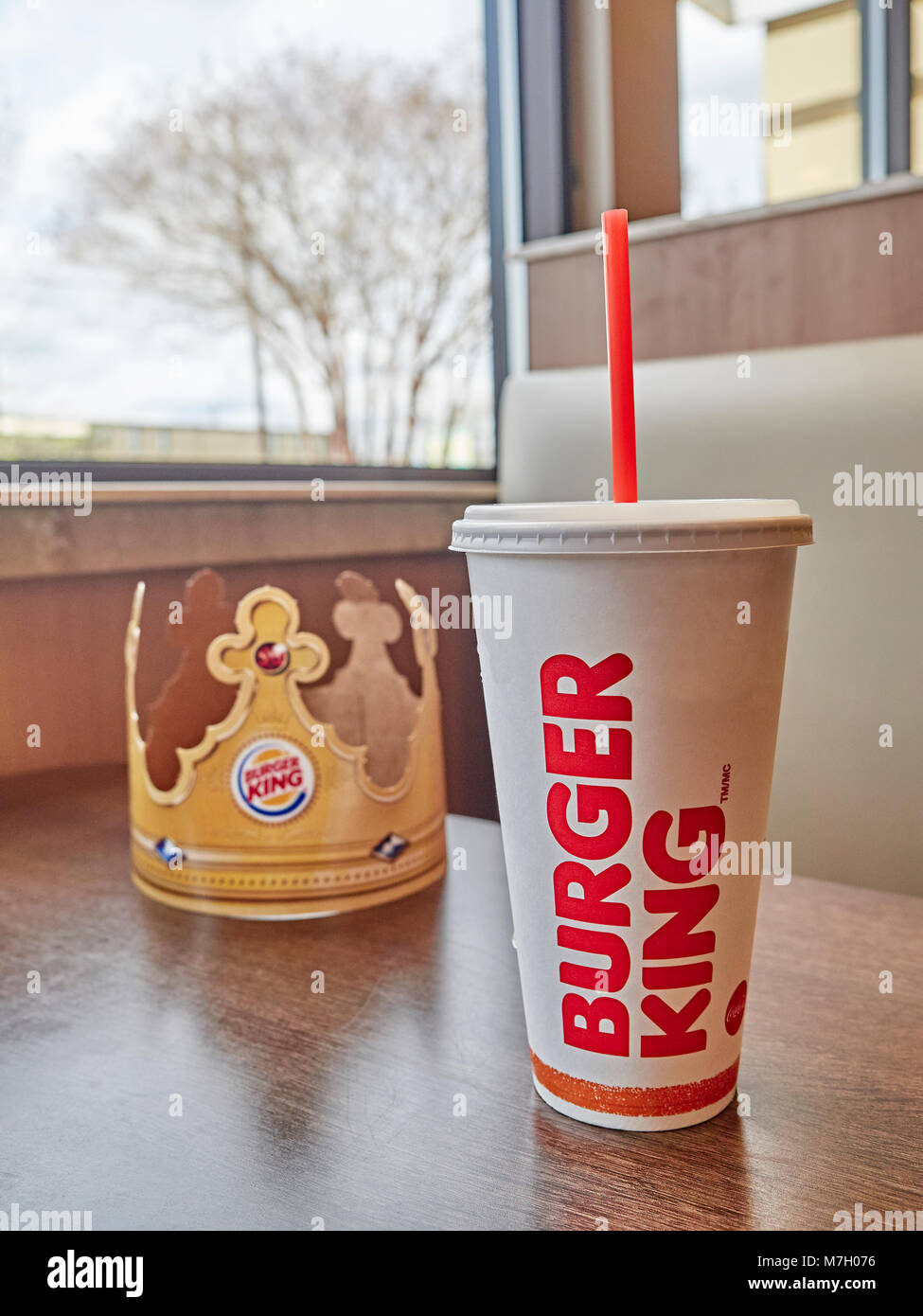 Drink cup and crown logo for the fast food restaurant Burger King. - Stock Image