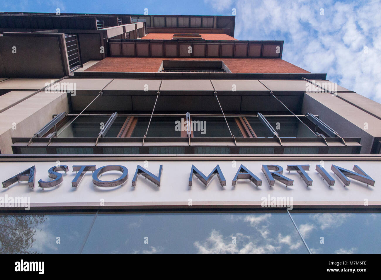 The famous Aston Martin logo on a car showroom in London - Stock Image