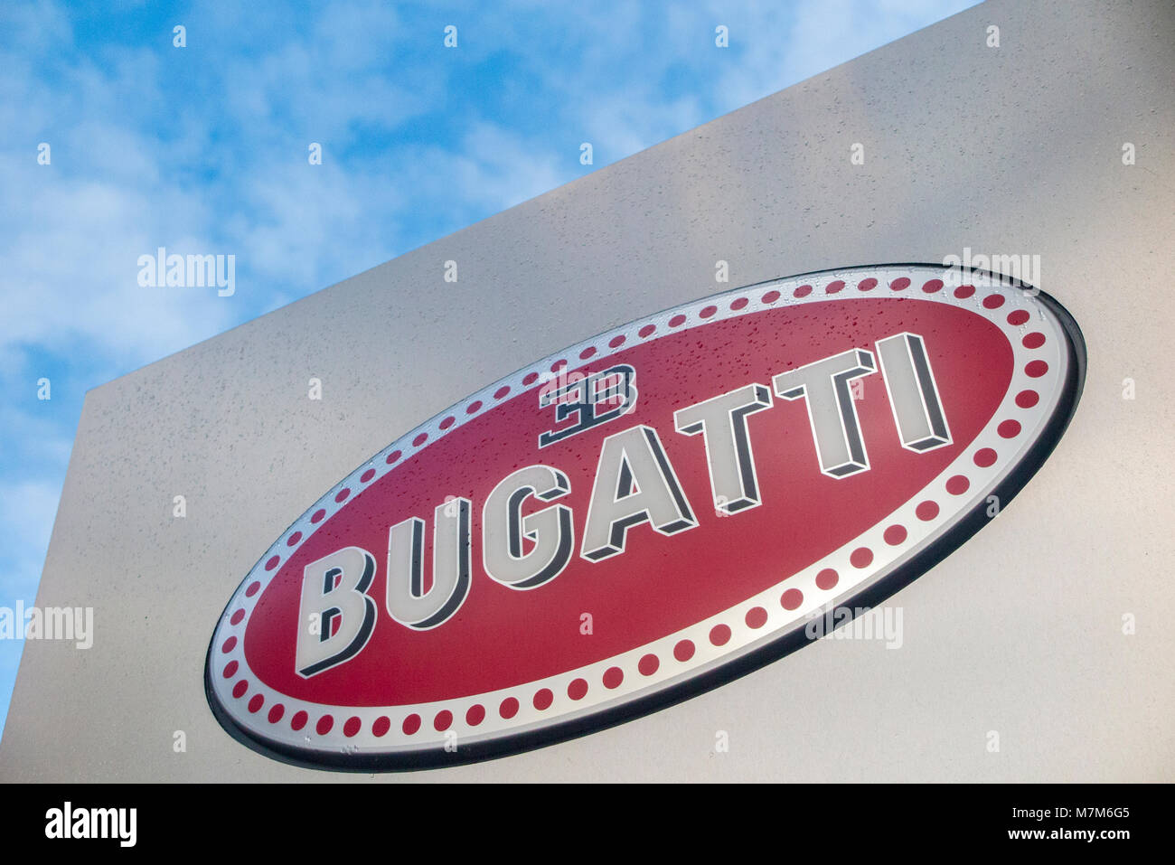 The Bugatti sign outside a showroom in central London - Stock Image