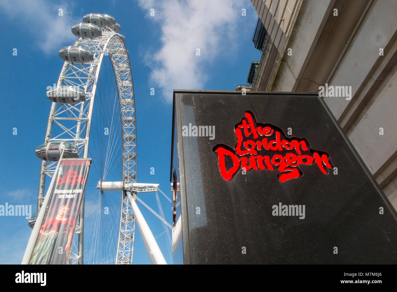 Tourism attractions in London - The London Dungeon and The London Eye - Stock Image