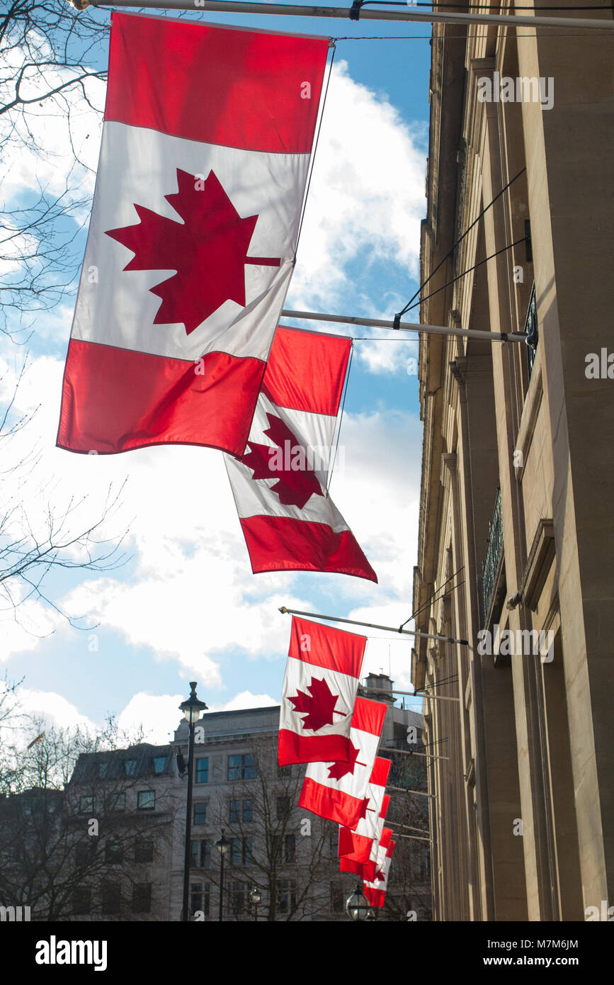 Flags outside the Canadian Embassy in London - Stock Image