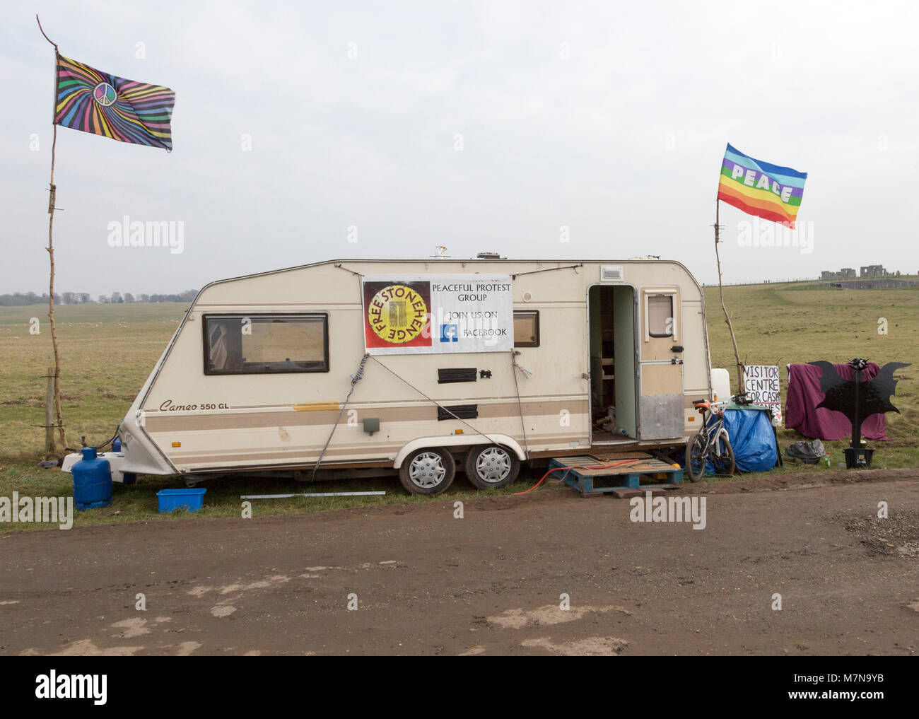 Caravan campaign banner Peace flag for 'Free Stonehenge, access campaign, Stonehenge, Wiltshire, England, UK - Stock Image