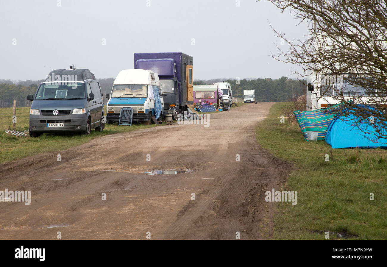 Vehicles of New Age travellers near Stonehenge, Wiltshire, England, UK - Stock Image