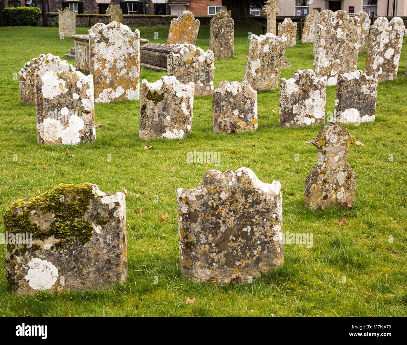 Weathered limestone gravestones, Amesbury Abbey church, Amesbury, Wiltshire, England, UK - Stock Image