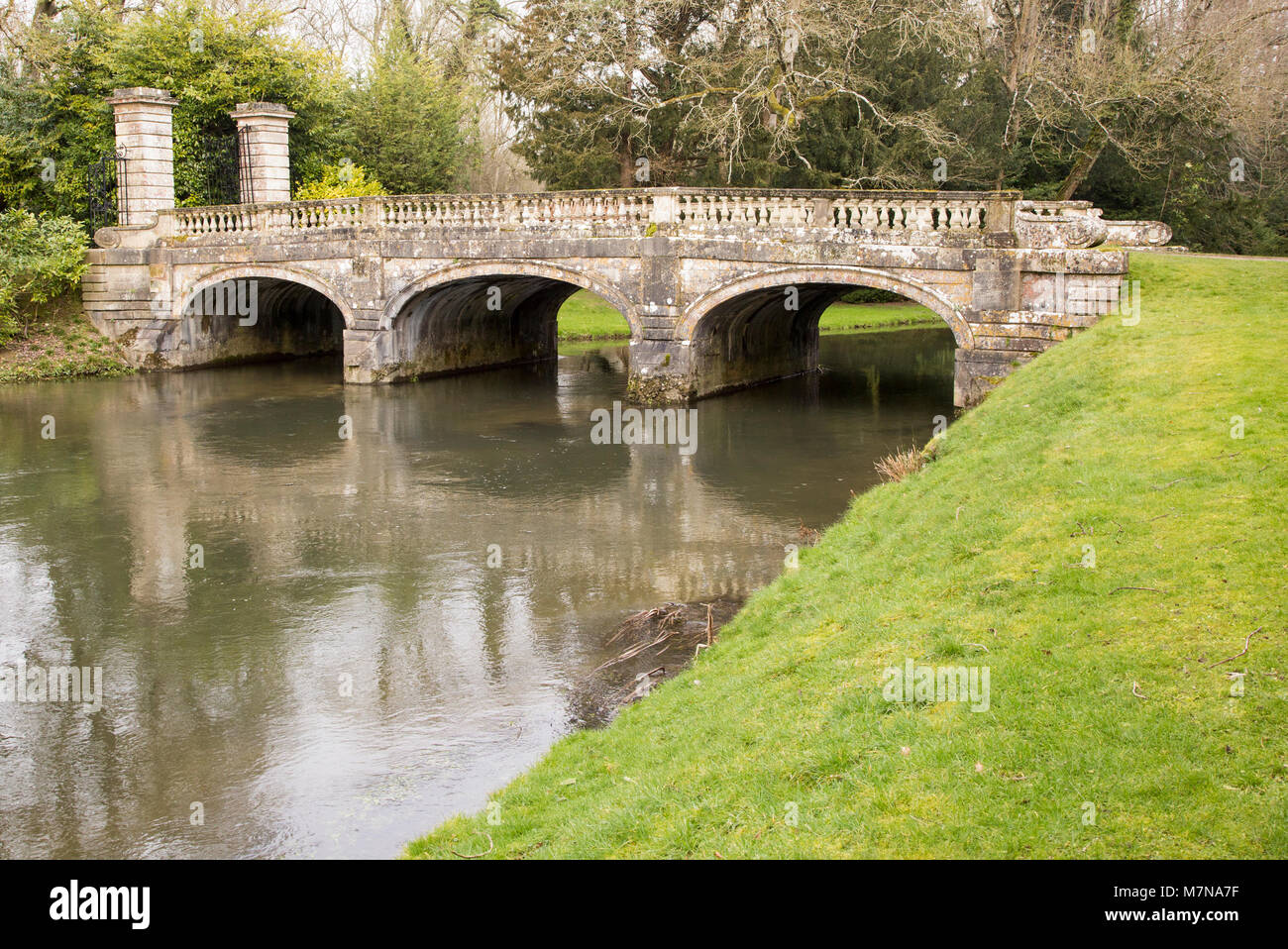 Ancient Weir Bridge over River Avon in Amesbury Abbey Park, Amesbury, Wiltshire, England, UK - Stock Image