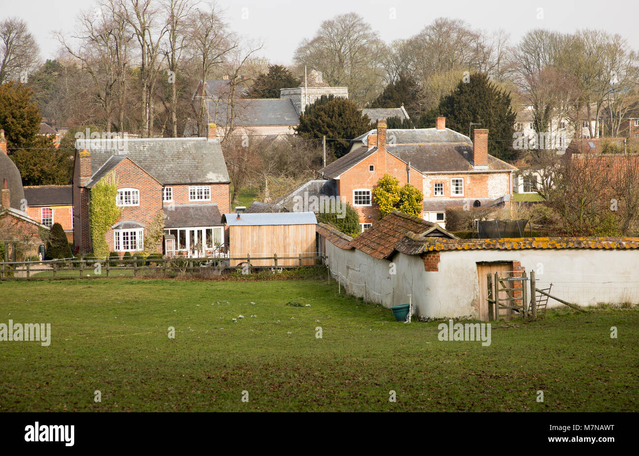 Buildings in valley floor of Tilshead village, Wiltshire, England, UK - Stock Image
