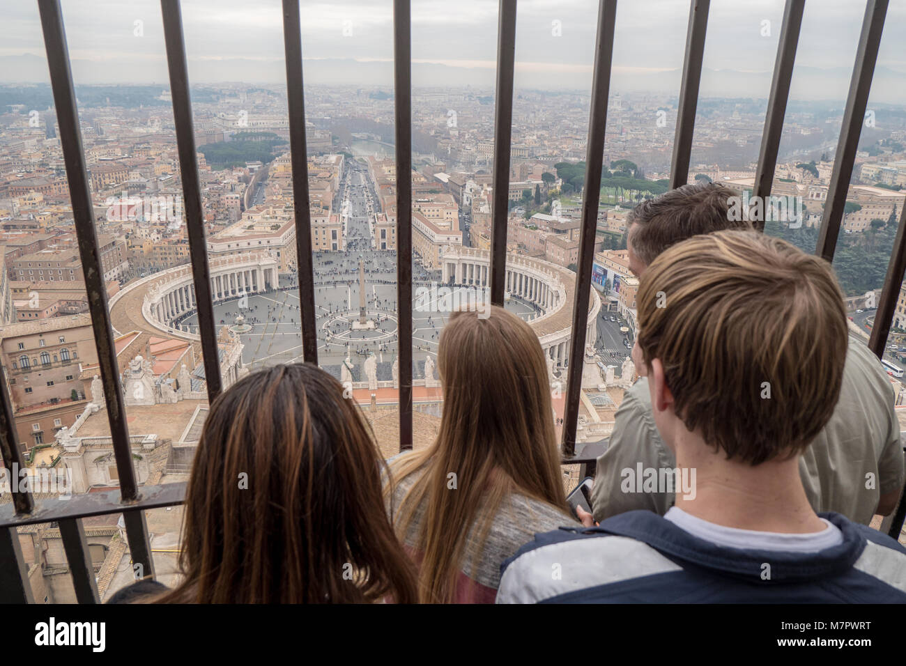 Tourists enjoying the view of Rome skyline from the top of St. Peter's Basilica in Rome, Italy - Stock Image