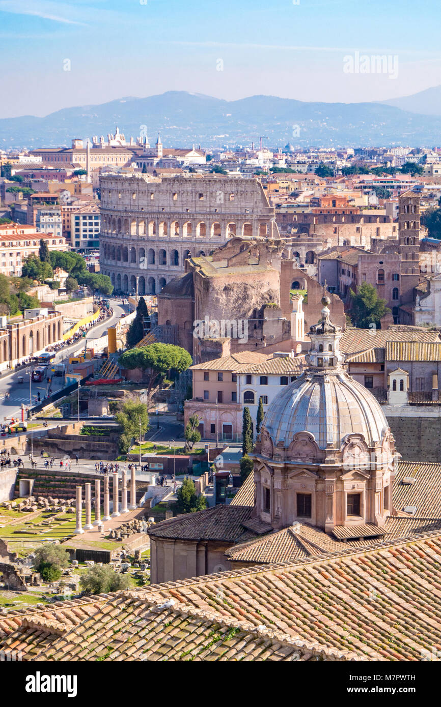 Rome skyline with the Colosseum visible in the back - Stock Image