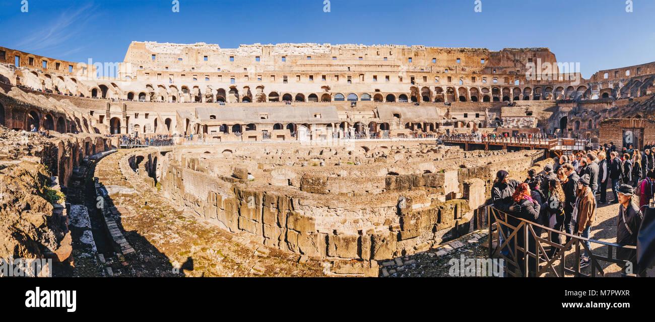 Rome, Italy, February 2018: Tourists anjoying the panorama inside  Colosseum, Rome, Italy - Stock Image
