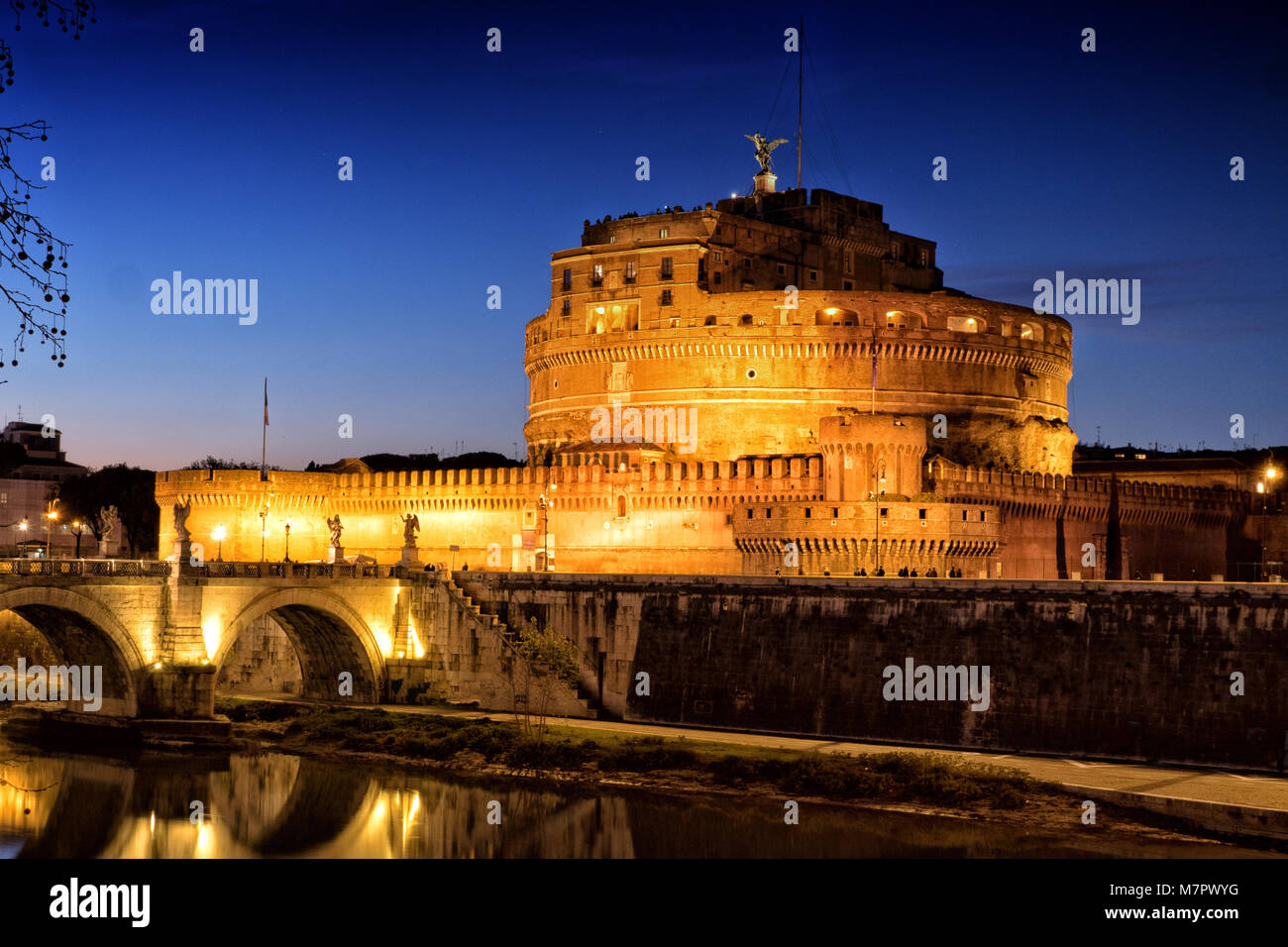 Rome Sant' Angelo Castle and Saint Angelo Bridge by night - Stock Image