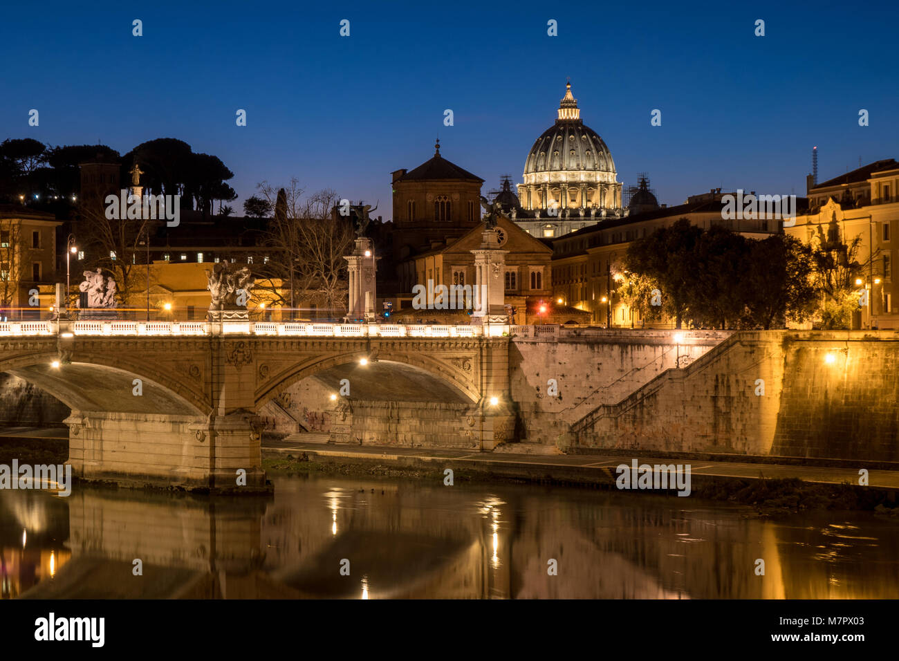 Rome at night with St. Peter Basilica in Vatican visible - Stock Image
