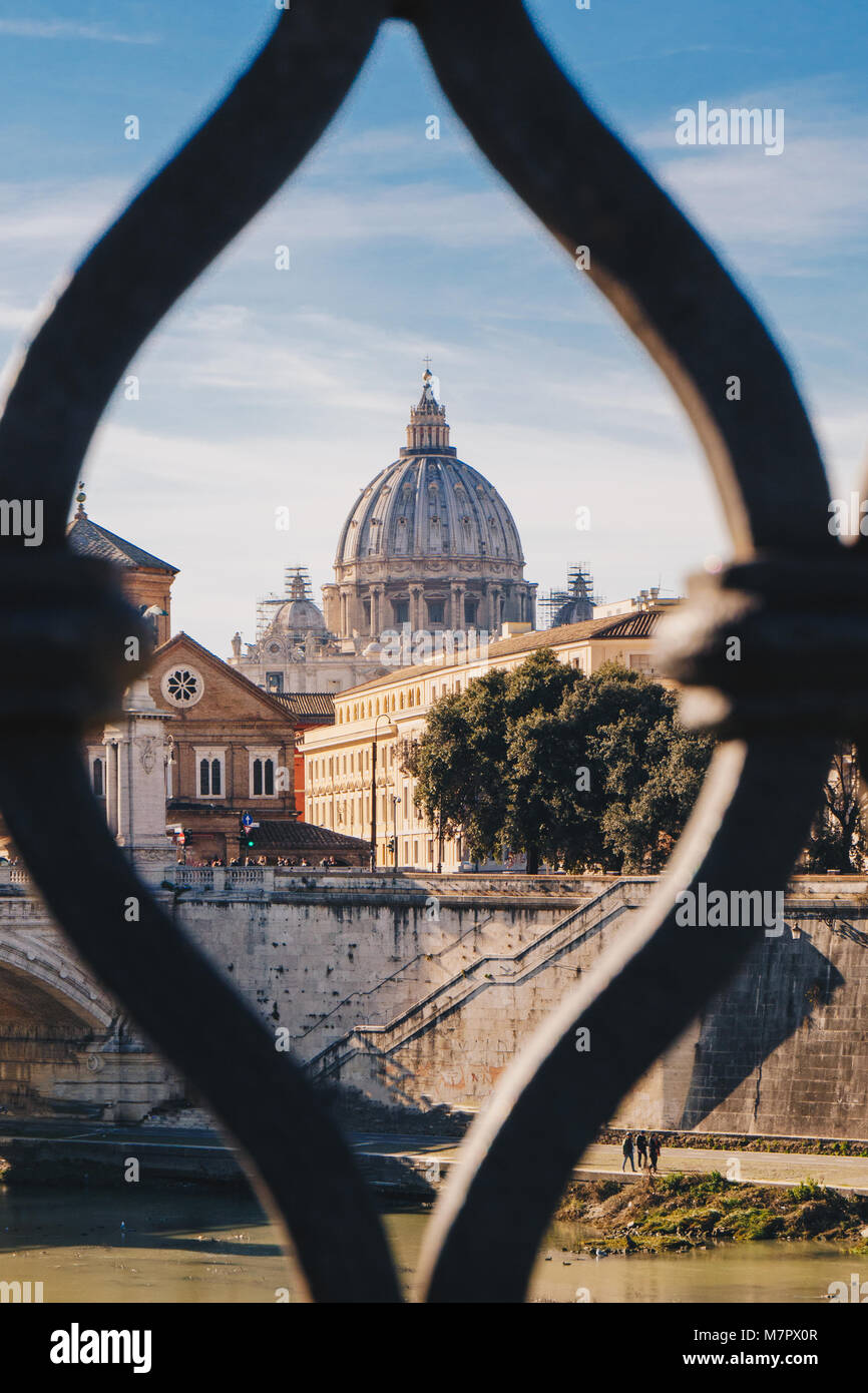 Basilica St. Peter in Vatican as seen from Sant' Angelo Bridge in Rome, Italy. Focus on the Basilica - Stock Image